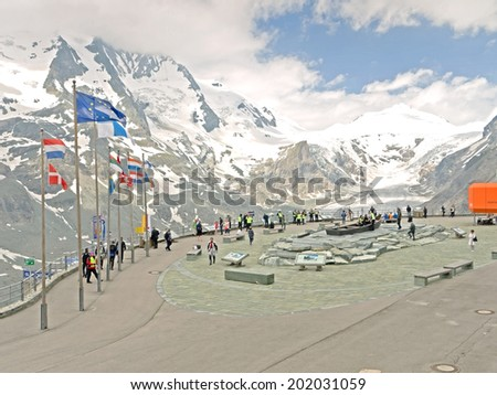 HEILIGENBLUT, AUSTRIA - 27 June 2014: Tourists at the visitor center at Kaiser-Franz-Josefs-Hoehe. The Pasterze glacier is in the background.  - stock photo
