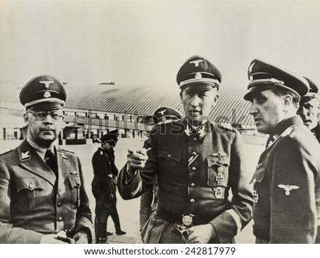 Heindrich Himmler (left)and Heydrich Reinhard (center), Hitler's architects of the Holocaust, in Paris, ca. 1940-42. Fritz Lang's 1943 film HANGMEN ALSO DIE is based on Heydrich's 1942 assassination. - stock photo