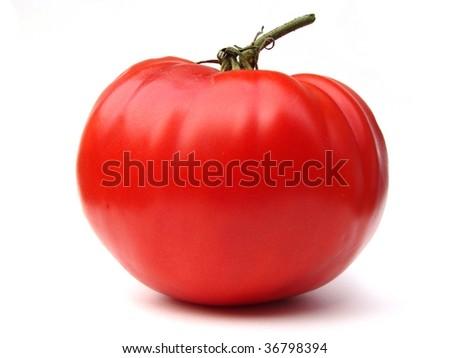 Heirloom Tomato, large close-up whole on white background - stock photo
