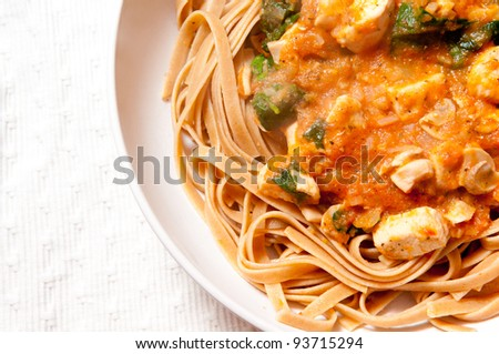 heirloom tomato sauce with diced chicken, cilantro, and fresh whole wheat fettucine noodles