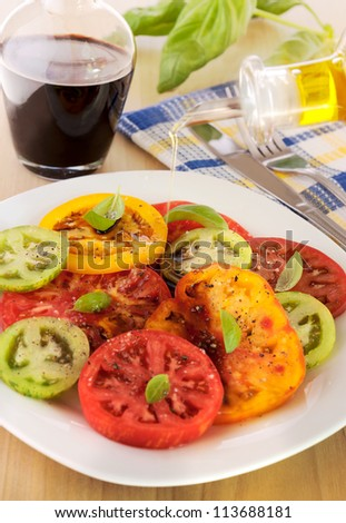 Heirloom tomatoes with olive oil and balsamic vinegar - stock photo