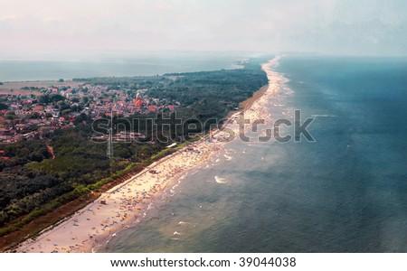 Hel peninsula on Baltic sea in Poland. Birds view. Below Jurata town summer touristic resort. People on the beach. - stock photo
