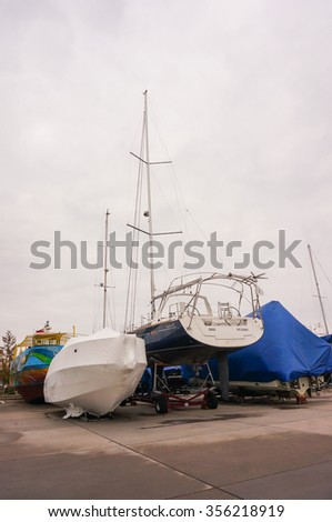 HEL, POLAND - NOVEMBER 13, 2015: Boats standing on a harbor on a cloudy day