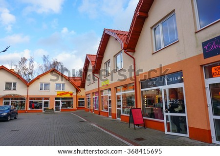 HEL, POLAND - NOVEMBER 12, 2015: Row of small shops and stores at a city center on a cloudy day