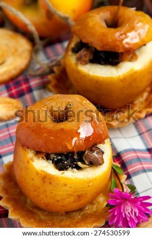 Helathy dessert - dried fruit stuffed baked apples - stock photo