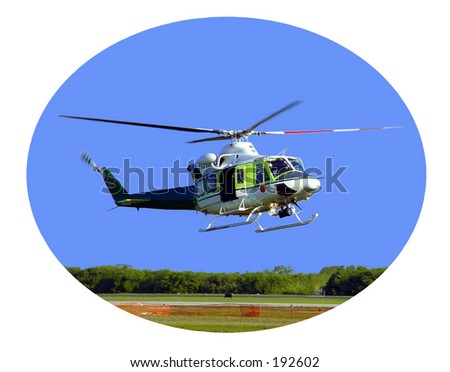 helicopter above heliport. - stock photo