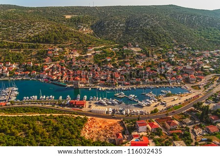 Helicopter aerial shoot of marina with boats and sailboats, Adriatic tourist destination near Trogir, Croatia - stock photo