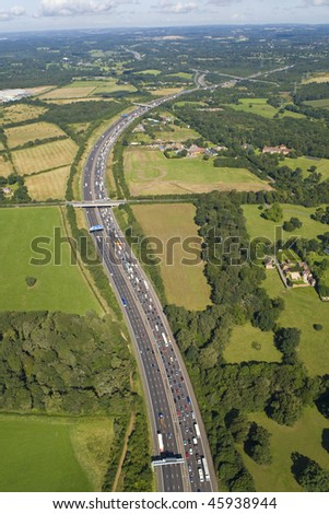Helicopter aerial shot of traffic congestion on the M25 motorway around London, England - stock photo