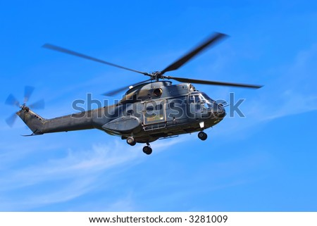 Helicopter against blue sky - stock photo
