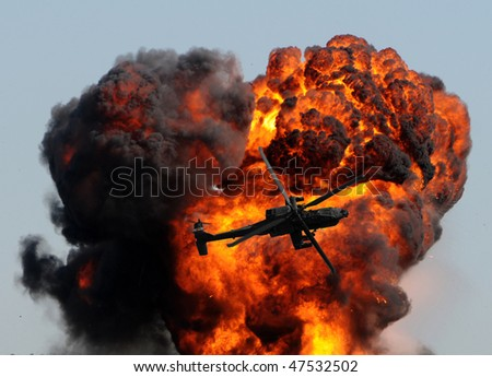 helicopter against giant fireball with smoke and flames - stock photo