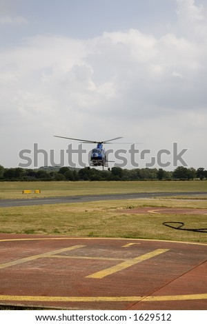 Helicopter and helipad - stock photo