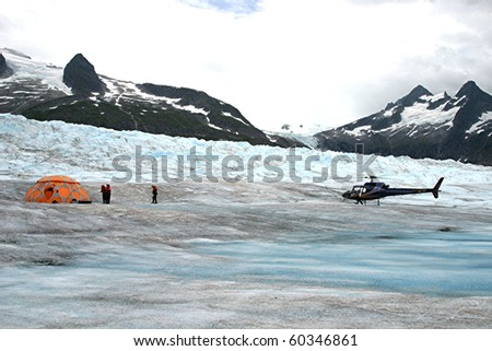 Helicopter and Hikers on Glacier