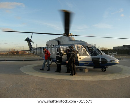 Helicopter arrives with passengers - stock photo