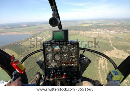 Helicopter Cockpit View - stock photo