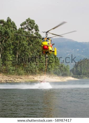 Helicopter fighting fire at Geres, north of Portugal - stock photo
