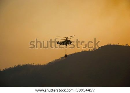 Helicopter fighting fire in Geres, north of Portugal - stock photo