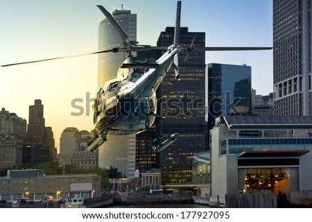 Helicopter flies through Manhattan South - stock photo