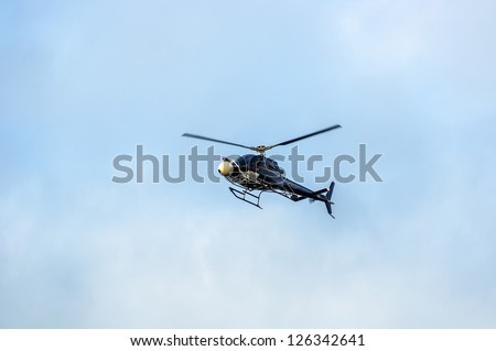 Helicopter flying high in the sky