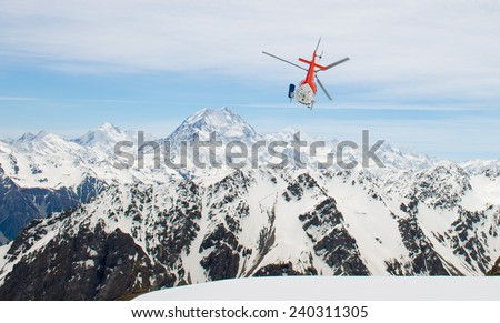 Helicopter flying over the amazing Southern Alps of New Zealand - stock photo