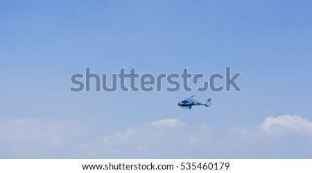 Helicopter flying trough the sky