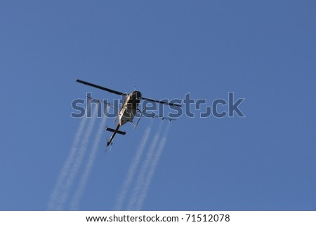 Helicopter Fumigating For Mosquito Control - stock photo