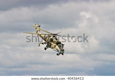 Helicopter gunship conducting high altitude training operations - stock photo