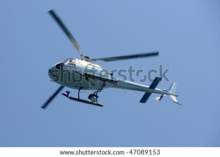 Helicopter holding video camera filming