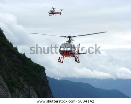 Helicopter in Fight - Helicopter Landing on Mendenhall, Glacier in Juneau Alaska - stock photo