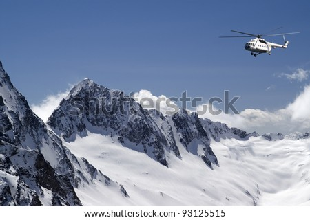 Helicopter in high mountains