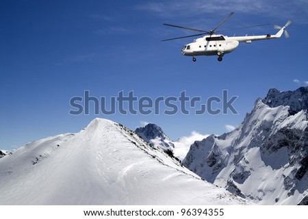 Helicopter in snowy mountains - stock photo