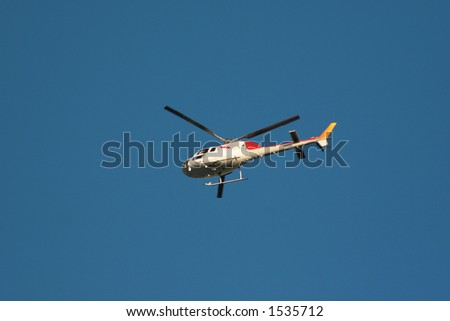 helicopter in the air - stock photo