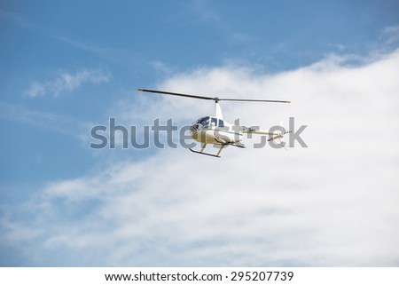 helicopter in the sky - stock photo