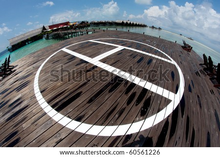 helicopter landing area at beautiful resort - stock photo