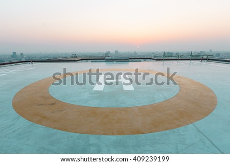 Helicopter landing area on the top of building tower - stock photo