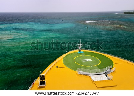 helicopter landing pad on a large ship in caribbean waters - stock photo