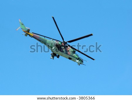 Helicopter Mi-24 opposite blue sky - stock photo