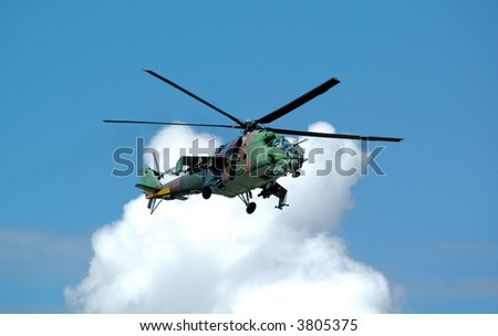 Helicopter Mi-24 opposite white cloud - stock photo
