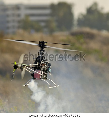 Helicopter model in flight - stock photo