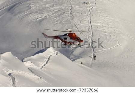 Helicopter mountain rescue service in the winter. Swinicka Pass in the High Tatras - stock photo