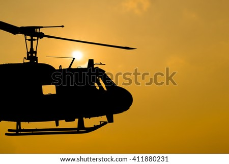helicopter on sunset. - stock photo