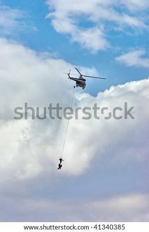 Helicopter on the cloudy background with special forces - stock photo