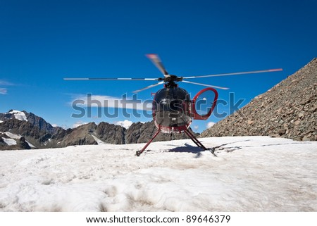 Helicopter on the top of Mount Cook. Southern Alps, West Coast, South Island, New Zealand. - stock photo