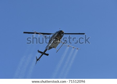 Helicopter Spraying Pesticide - stock photo