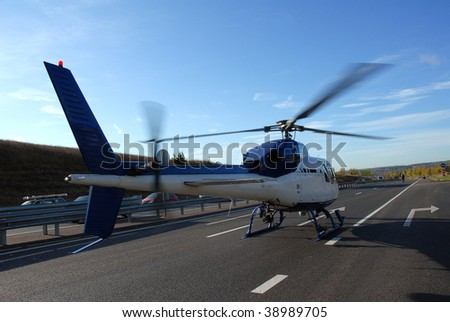 helicopter standing on a highway