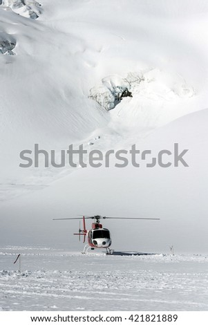 Helicopter to snow mountain
