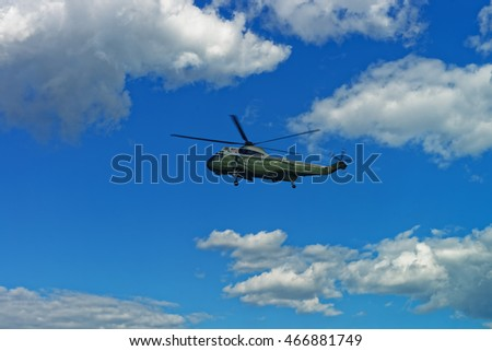 Helicopter was seen flying in the sky near the White House in Washington D.C., USA. The White House is the residence and workplace of the current United States President.