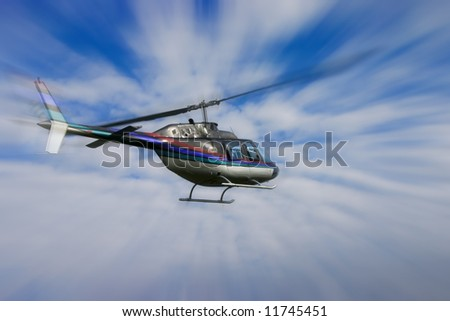 Helicopter with a strong zoom against a blue and cloudy sky