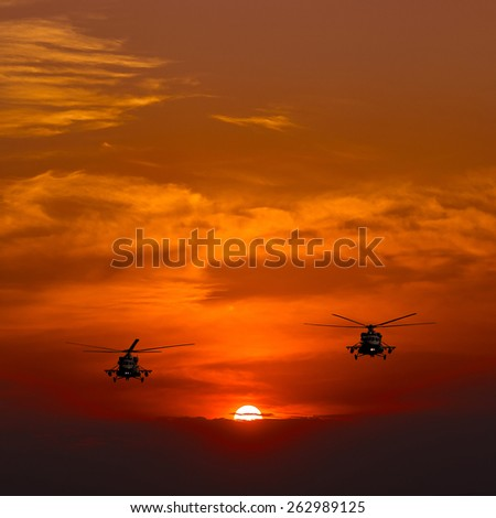 Helicopters Mi-8, warm sunset