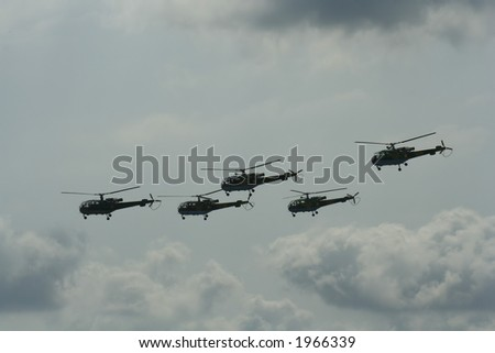 helicopters squadron flying in close formation