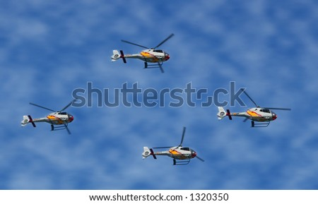 helicopters surfing clear sky. Space for text - stock photo